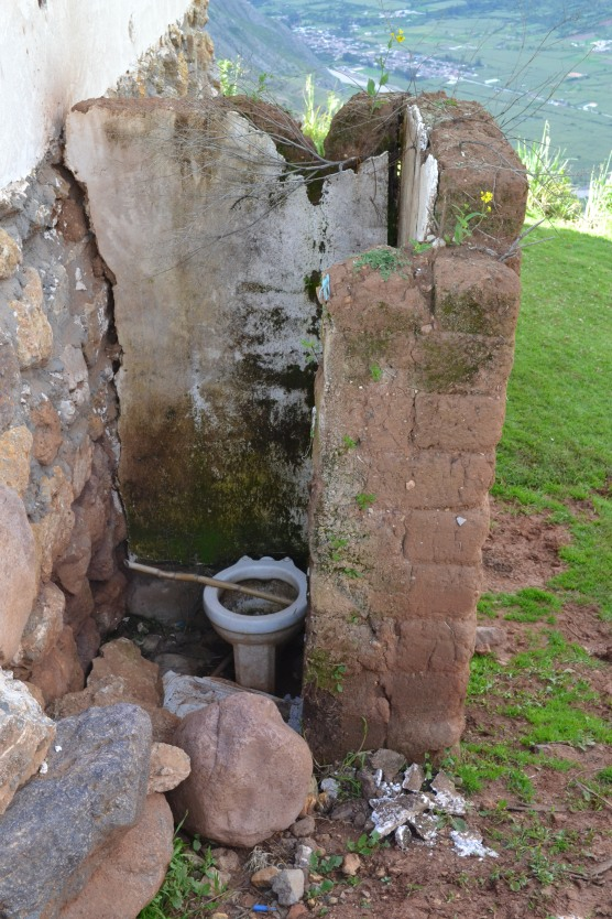 A toilet found at a small house in the middle of the mountains. No TP or seat!